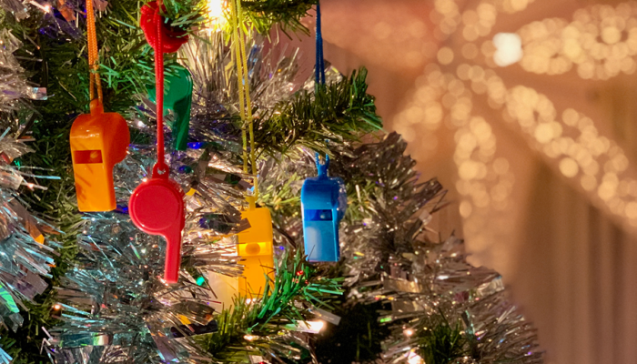 Colorful whistles in a Christmas tree